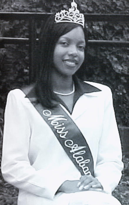 ReKendra L. Evans, named campus queen in 1999, seated in regalia.