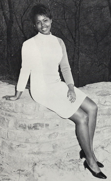 Gail Davis, named campus queen in 1968, seated outdoors.