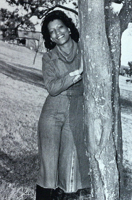 Karen Russel, named campus queen in 1976, standing outdoors.