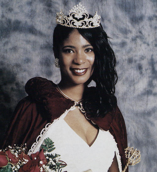 Akilah Harmon, named campus queen in 1997, in gown and regalia.