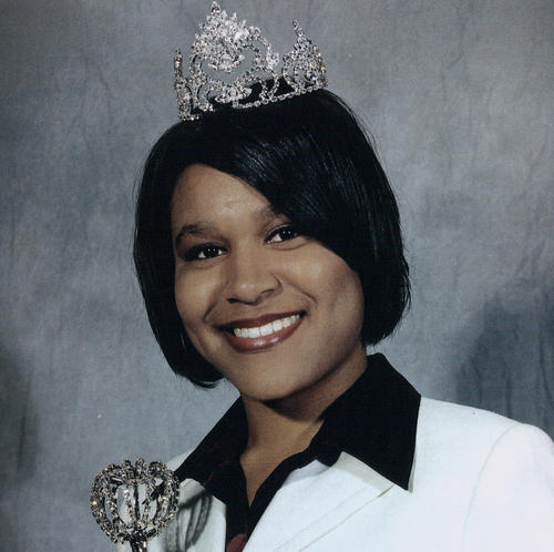 Crystal A. Bost, named campus queen in 2000, wearing crown and regalia.