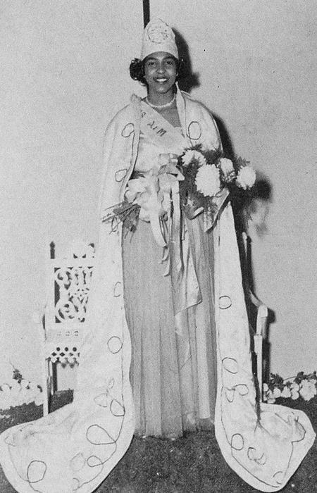 Ann Crews Smith, named campus queen in 1950, standing in gown and regalia., black-and-white photography., Digitized 2014-09 J. F. Drake Memorial LRC, Alabama A&M University.
