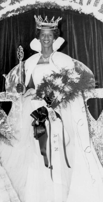 Mattie Harper, named campus queen in 1955, in gown and regalia., Digitized 2014-09 J. F. Drake Memorial LRC, Alabama A&M University.
