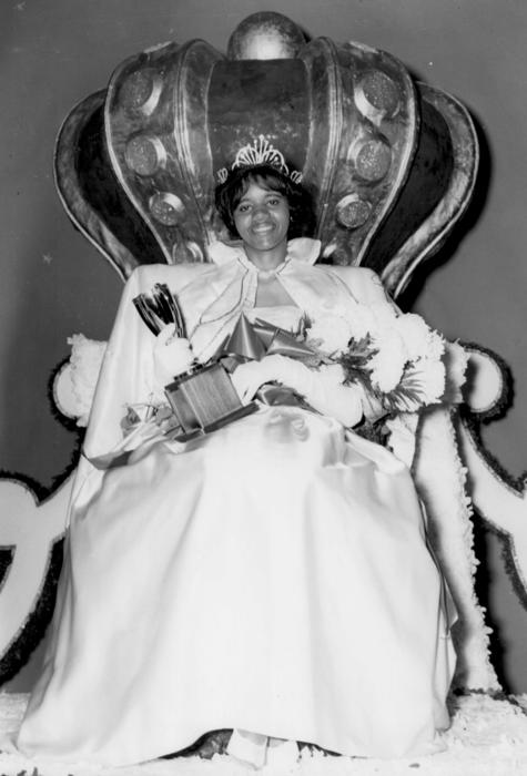 Dorothy Thompson, named campus queen in 1963, seated in gown and holding a trophy., Digitized 2014-09 J. F. Drake Memorial LRC, Alabama A&M University.
