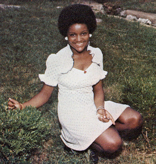 Thelma Chambers, named campus queen in 1974, seated on a lawn., Digitized 2014-09 J. F. Drake Memorial LRC, Alabama A&M University.
