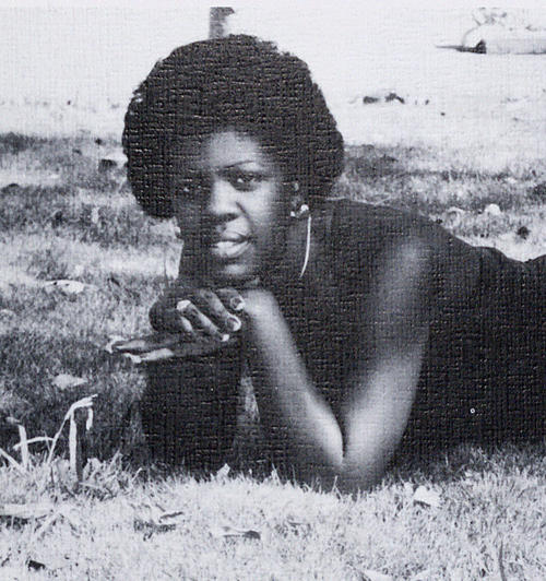 Emma Ford, named campus queen in 1977, lying outdoors., Digitized 2014-09 J. F. Drake Memorial LRC, Alabama A&M University.