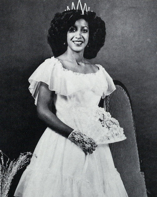 Deborah Bearden, named campus queen in 1980, standing in gown with lace fan., Digitized 2014-09 J. F. Drake Memorial LRC, Alabama A&M University.