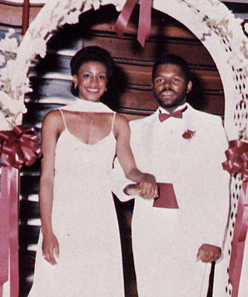 Regina Nicholson, named campus queen in 1984, standing with escort., Digitized 2014-09 J. F. Drake Memorial LRC, Alabama A&M University.