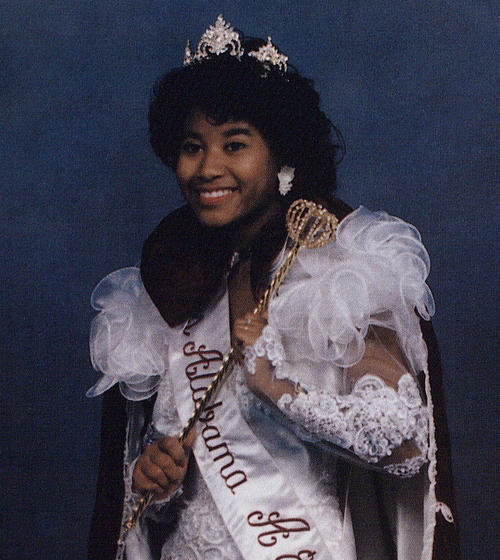 Alnita Baker, named campus queen in 1992, standing in gown and regalia., Digitized 2014-09 J. F. Drake Memorial LRC, Alabama A&M University.