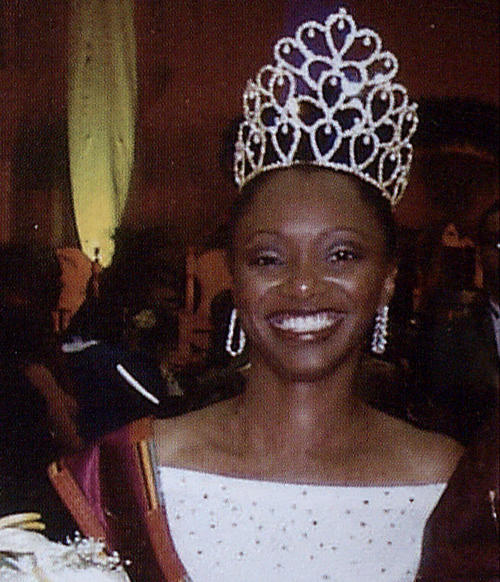 Hadiyah Nicole Green, named campus queen in 2002, in gown and regalia., Digitized 2014-09 J. F. Drake Memorial LRC, Alabama A&M University.