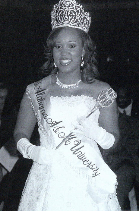 Lauren LaValle, named campus queen in 2005, standing in gown and regalia., Digitized 2014-09 J. F. Drake Memorial LRC, Alabama A&M University.