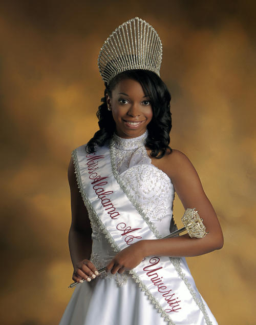 Monique Morris, named campus queen in 2012, standing in gown and regalia., Digitized 2014-09 J. F. Drake Memorial LRC, Alabama A&M University.
