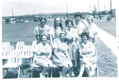 Digitized by J.F. Drake Memorial LRC; Alabama A&M University., Eight nursing faculty posing out on the quad.