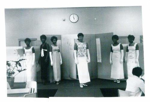 Digitized by J.F. Drake Memorial LRC; Alabama A&M University., Carolyn Green (center student) on the runway with five other students in evening apparel.