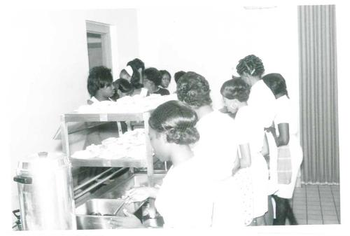 Digitized by J.F. Drake Memorial LRC; Alabama A&M University., College students in the serving line of the cafetorium.