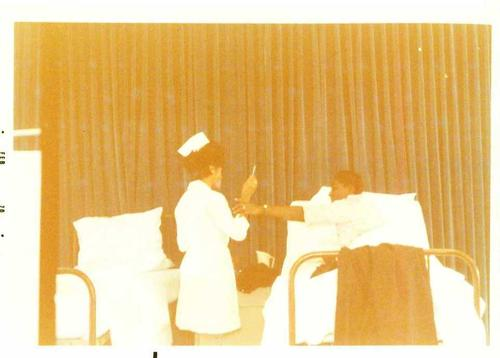 Digitized by J.F. Drake Memorial LRC; Alabama A&M University., A nursing student and 'patient' providing a demonstration.