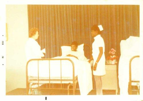Digitized by J.F. Drake Memorial LRC; Alabama A&M University., A nursing student, faculty member, and 'patient' providing a demonstration.