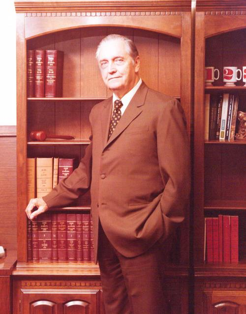 Mr. T. L. Faulkner posing in front of a bookshelf. Dr. Faulkner was the Director of Vocational-Technical-Higher Education for the State Department of Education (1973). In 1959 he was also the State Supervisor of Vocational Agriculture and the director of the FFA., Digitized by J.F. Drake Memorial LRC; Alabama A&M University.