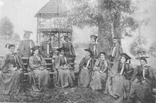 The Huntsville State Normal School for Negroes first graduating class at the Ye Old Spring in Normal AL consisting of 12 students, 11 females and 1 male. Back row, from left: R. A. Thompson, J. E. Walker, R. B. Stamps, R. L. Houston, J. C. Barne. Front row, from left: L. V. Brownlow, A. L. Gray, Sarah F. Adams, Miss Duncan, A. H. Halfarce, D. W. McCall, and H. K. Patrick. Source: Encyclopedia of Alabama.