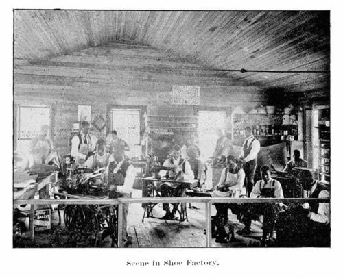 Men working in shoe factory on campus.